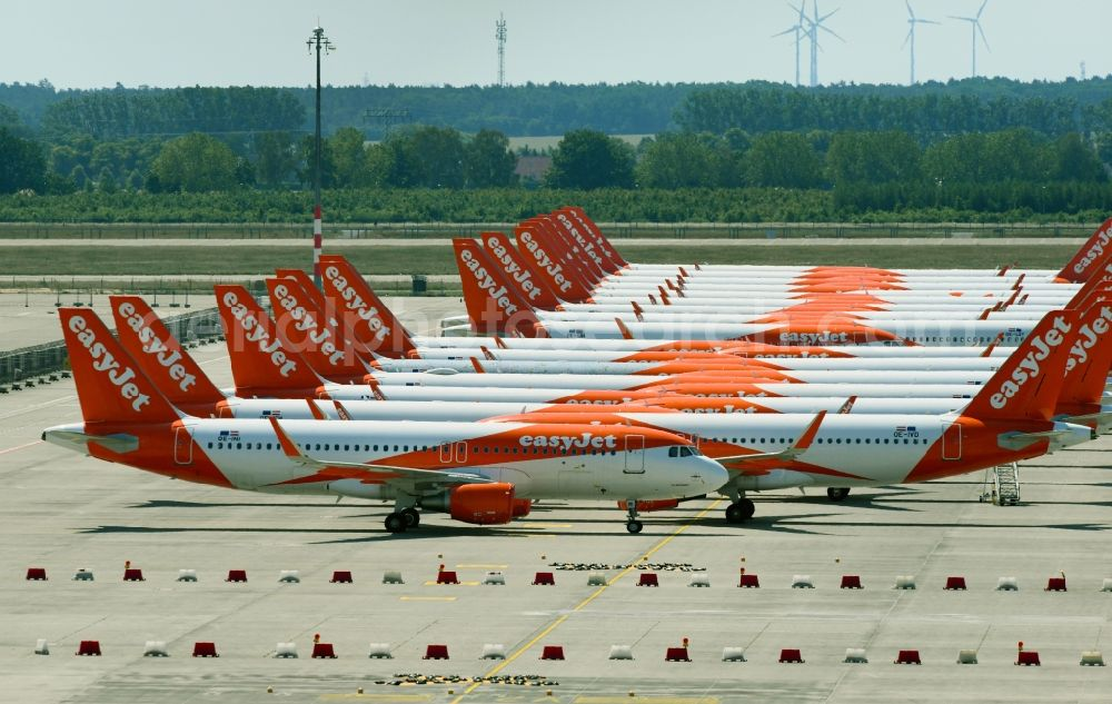 Schönefeld from the bird's eye view: Passenger airplanes of airline easyjet - closed due to crisis - in parking position - parking area at the airport in Schoenefeld in the state Brandenburg, Germany