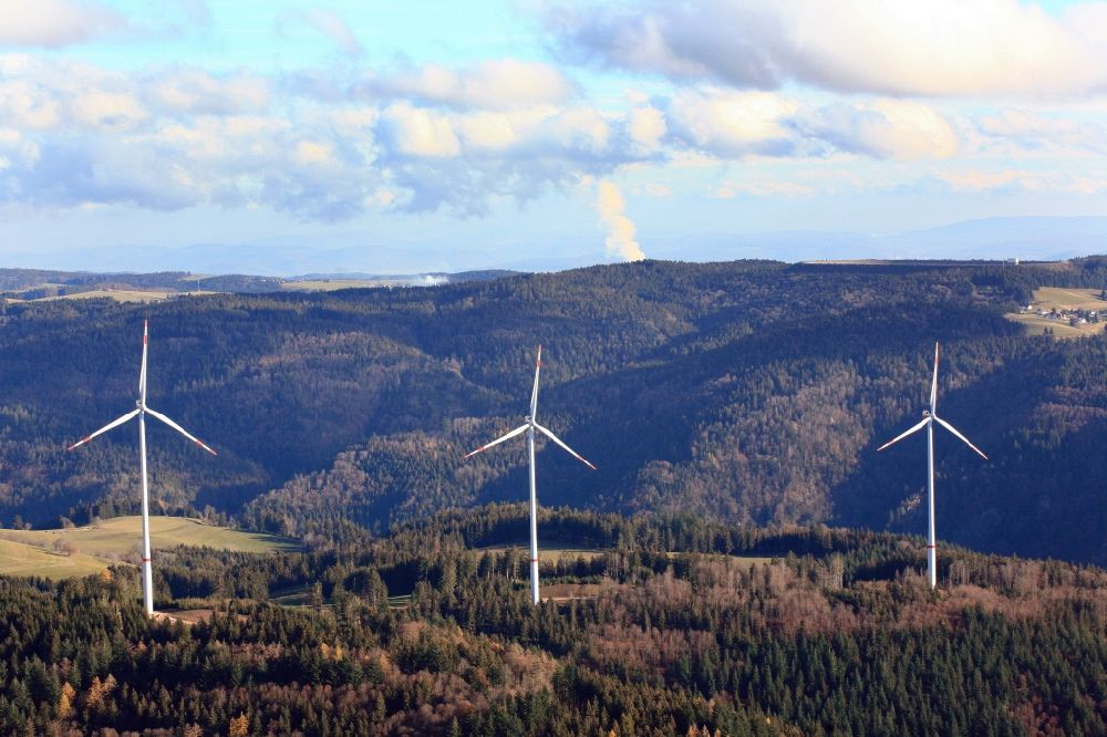 Aerial image Hasel - Wind turbines of the wind farm Glaserkopf in the Black Forest in Hasel in the state Baden-Wurttemberg, Germany. In the background the steam column of Swiss nuclear power plant Leibstadt KKL. Symbolic image for the controversial debate of nuclear power versus renewable power.