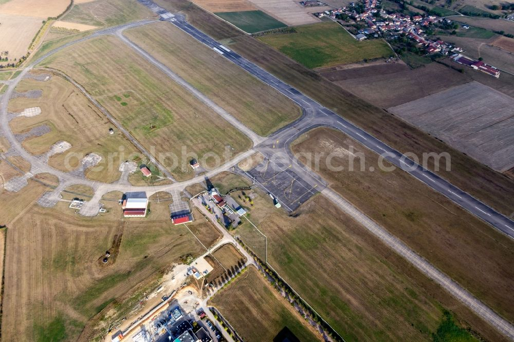 Aerial image Juvaincourt - Runway with tarmac terrain of airfield Aeroport d'Epinal - Mirecourt in Juvaincourt in Grand Est, France