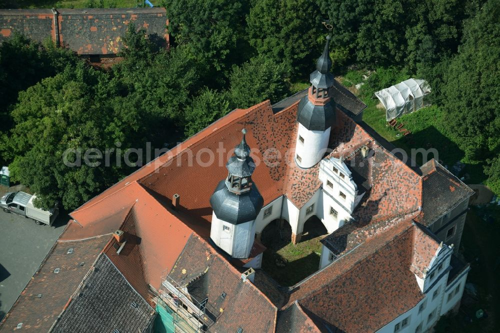 Zschepplin from above - Building and Park of Castle Zschepplin in Zschepplin in the state of Saxony. The castle with its church, yard and towers is located in a forest on the edge of Zschepplin