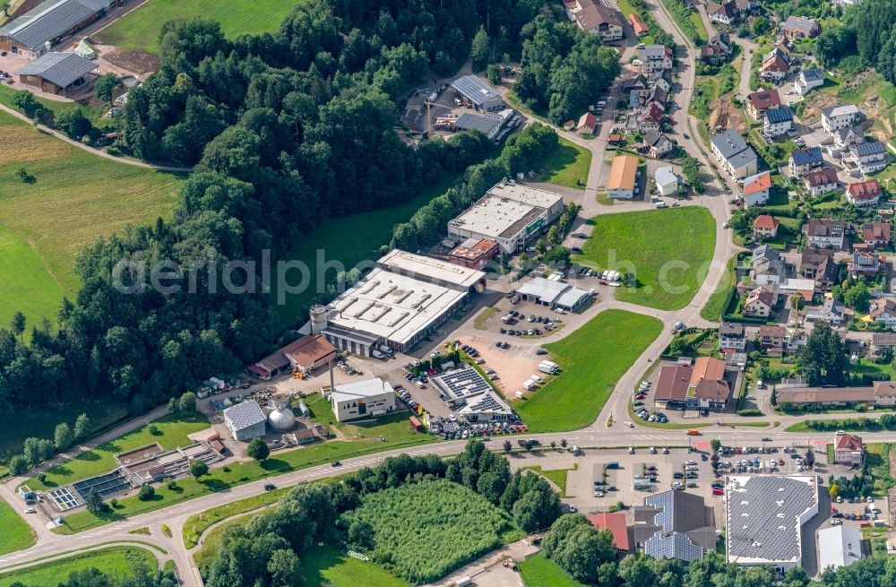 Elzach from the bird's eye view: Mixed development of commercial units and company branches in the residential area of a single-family housing estate Im Suedwesten von Elzach in Elztal in Elzach in the state Baden-Wuerttemberg, Germany