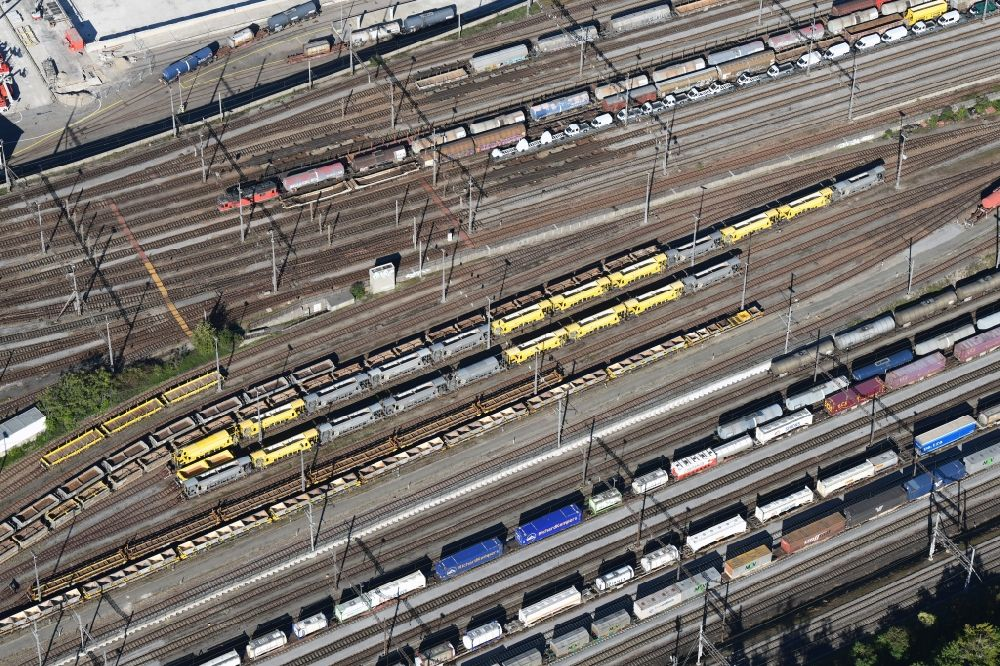 Aerial image Muttenz - Railway tracks and cargo trains in the route network of the Swiss Railway SBB in Muttenz in the canton Basel-Landschaft, Switzerland.