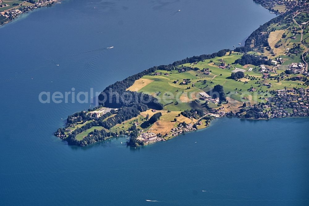 Weggis from the bird's eye view: Peninsula with land access and shore area on the Vierwaldstaetter See in Weggis in the canton Luzern, Switzerland