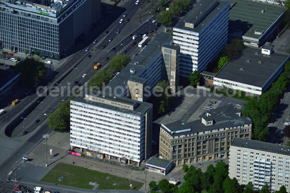Berlin from above - The building complex house of Statistics is located in the Otto-Braun-Strasse in the Mitte district of Berlin. Designed by the architect Hoerner, Senf and Haerter building was built as an administrative and commercial buildings and used for many years, among others, the Central State Office for Statistics of the GDR. After the turn here was the Berlin office of the Federal Commissioner for the Stasi Archives. Since the extract, the building is unused. The oblique construction in the Karl-Marx-Allee is the house of health, in which the AOK health insurance company has an office.
