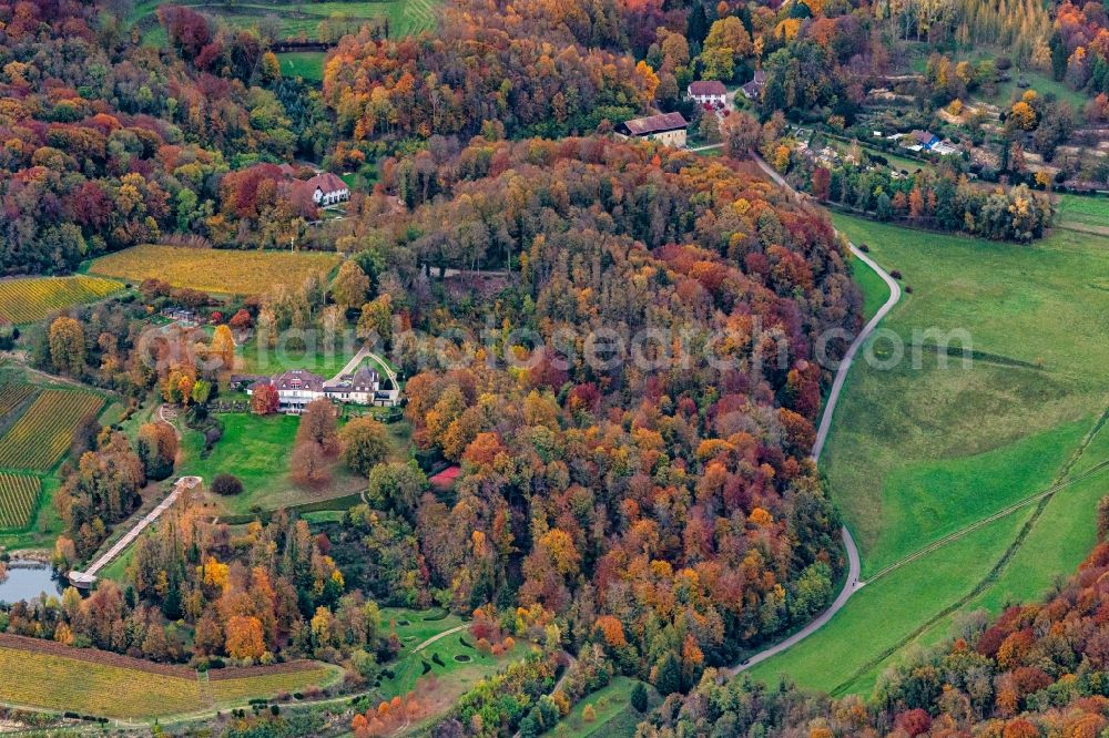 Aerial photograph Ihringen - Autumnal discolored vegetation view building and manor house of the farmhouse in Ihringen in the state Baden-Wurttemberg, Germany