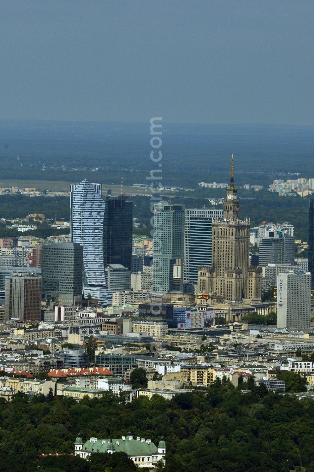 Warschau from the bird's eye view: Skyscraper skyline in the city center of Warsaw in Poland. The series of buildings ranging from the landmark high-rise buildings of the Palace of Culture and Science, the Zlota 44, Blue Tower Plaza; Hotel Inter-Continental; Warsaw Financial Center; Rondo 1-B; Oxford Tower and other.