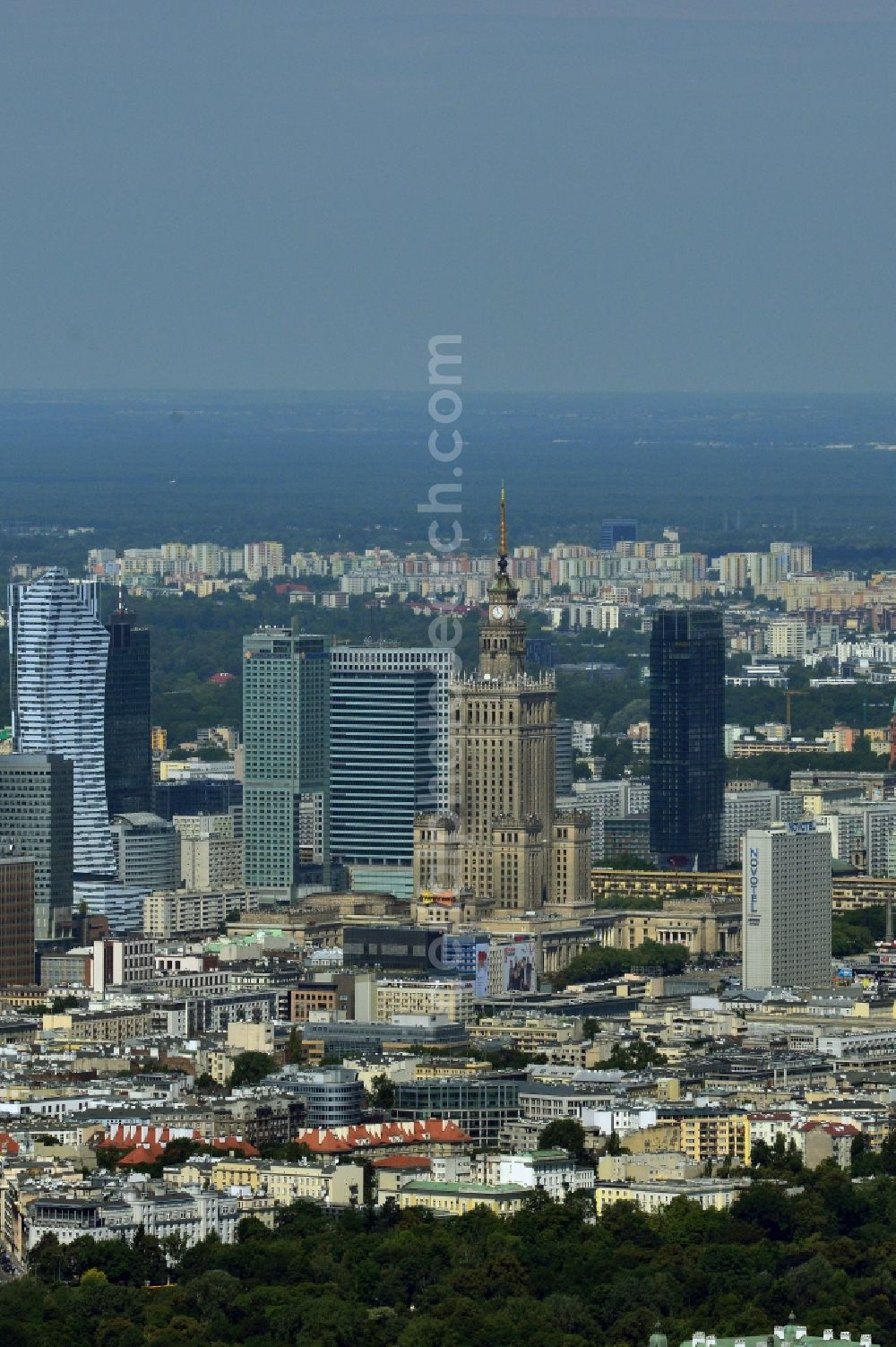 Aerial photograph Warschau - Skyscraper skyline in the city center of Warsaw in Poland. The series of buildings ranging from the landmark high-rise buildings of the Palace of Culture and Science, the Zlota 44, Blue Tower Plaza; Hotel Inter-Continental; Warsaw Financial Center; Rondo 1-B; Oxford Tower and other