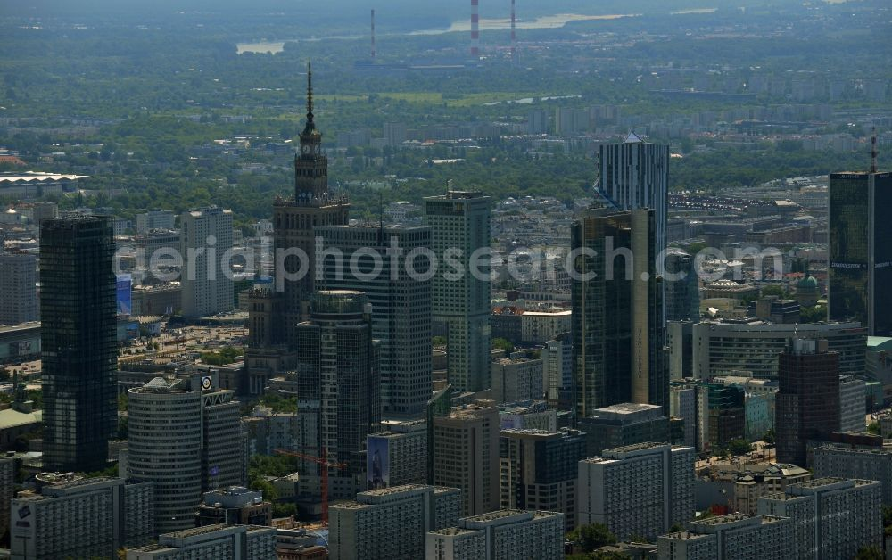 Aerial image Warschau - Skyscraper skyline in the city center of Warsaw in Poland. The series of buildings ranging from the landmark high-rise buildings of the Palace of Culture and Science, the Zlota 44, Blue Tower Plaza; Hotel Inter-Continental; Warsaw Financial Center; Rondo 1-B; Oxford Tower and other