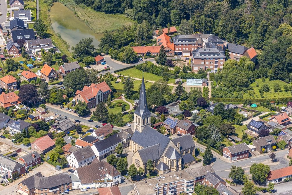 Nordwalde from above - Church building of St. Dionysius on Amtmann-Daniel-Strasse overlooking the St. Franziskus-Haus on Proebstingstrasse in Nordwalde in the state North Rhine-Westphalia, Germany