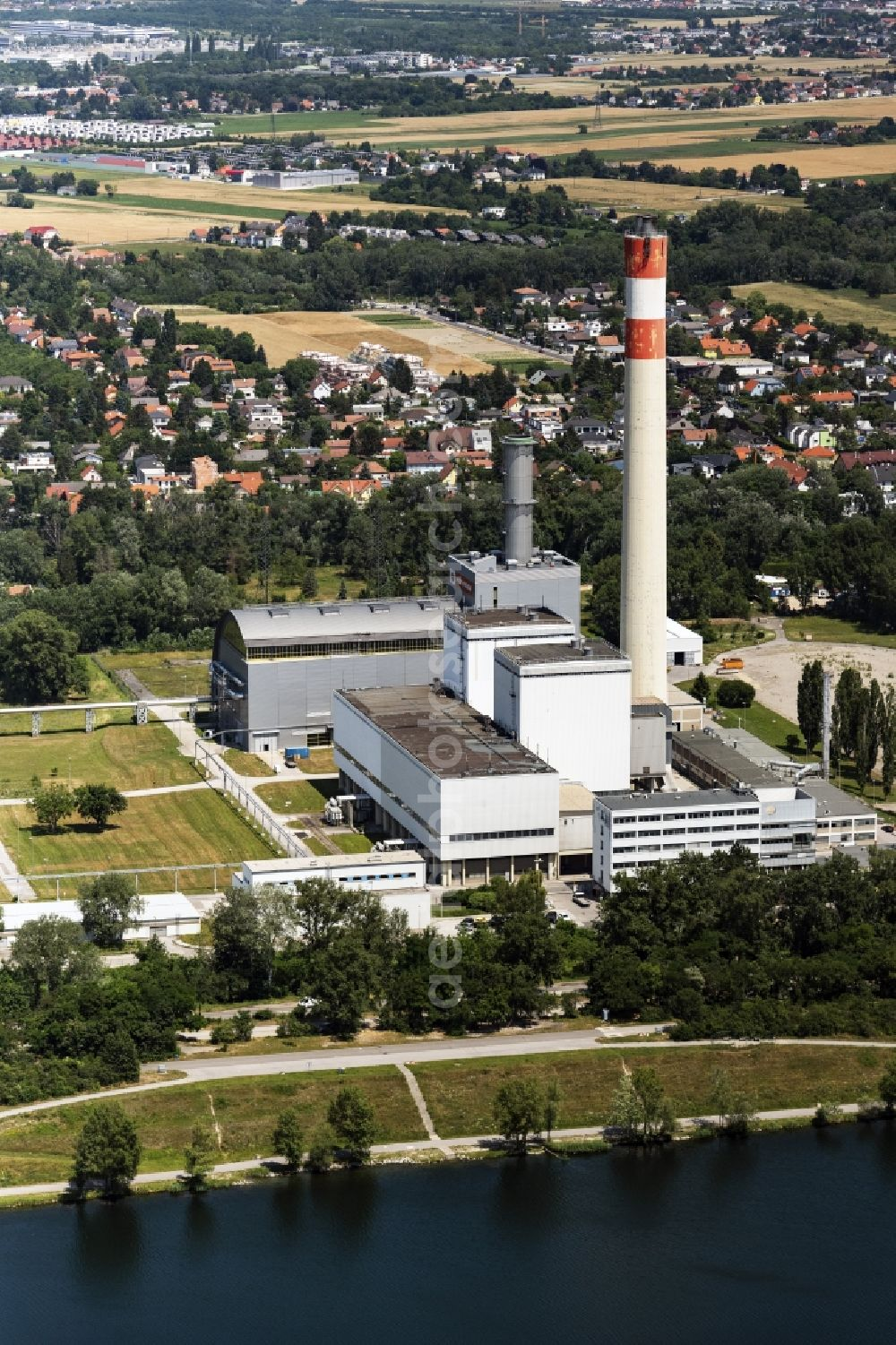 Wien from above - Power plants and exhaust towers of thermal power station KWK-Kraftwek Donaustadt in Vienna in Austria.