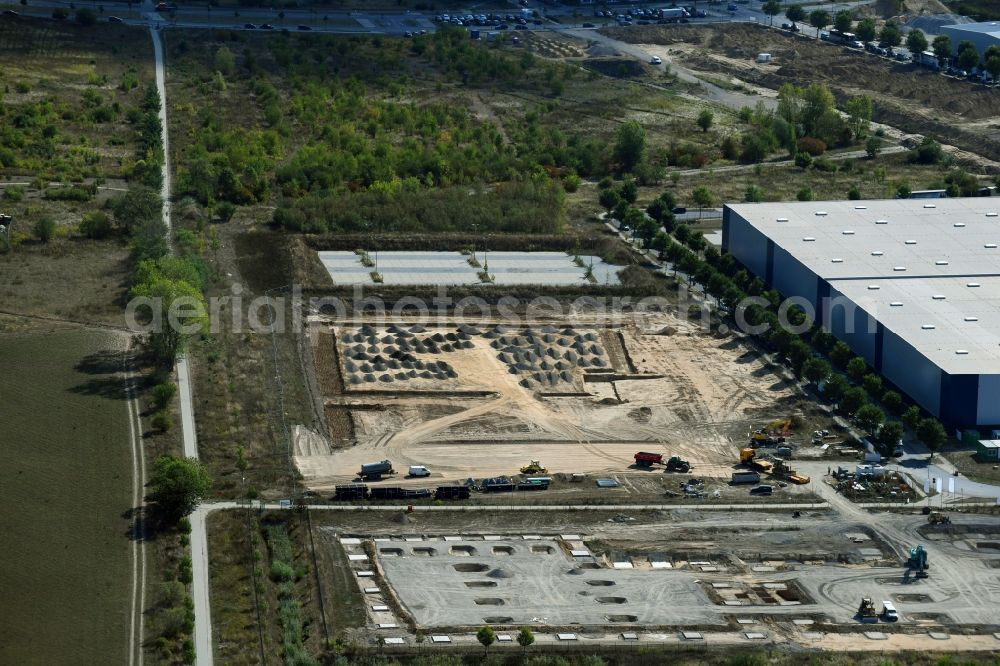 Schönefeld from the bird's eye view: Construction site for a warehouse and forwarding building An den Gehren - Mizarstrasse in Schoenefeld in the state Brandenburg, Germany.