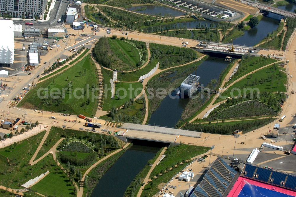 London from the bird's eye view: Park Live in the Olympic Park with a giant double-sided screen in the River Lea broadcasting live the Olympic and Paralympic venues for the 2012 Games in Great Britain. A joint venture between the Organising Committee and British Airways