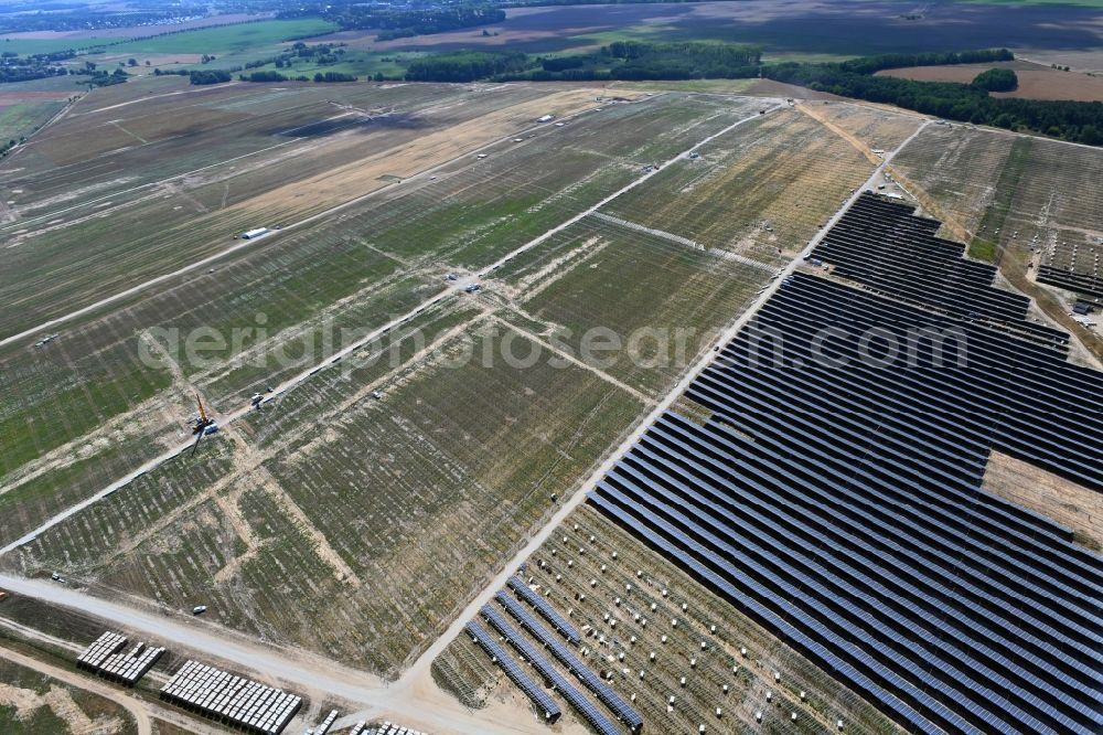 Aerial photograph Willmersdorf - Construction site and assembly work for solar park and solar power plant in Willmersdorf in the state Brandenburg, Germany
