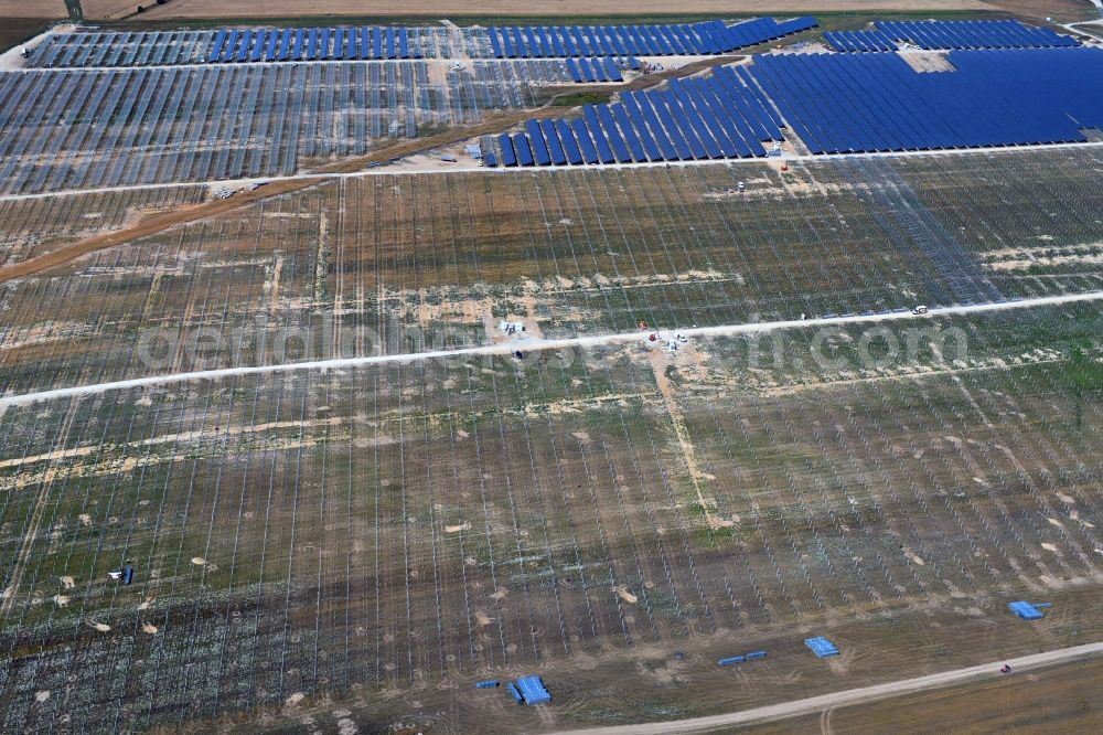 Willmersdorf from the bird's eye view: Construction site and assembly work for solar park and solar power plant in Willmersdorf in the state Brandenburg, Germany