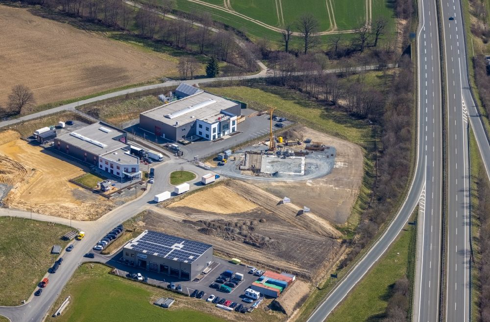 Aerial photograph Meschede - New building construction site in the industrial park Auf dem Bruch overlooking the company buildings of Eventtechnik Suedwestfalen and the JUMA Logistik GmbH in the district Enste in Meschede in the state North Rhine-Westphalia, Germany