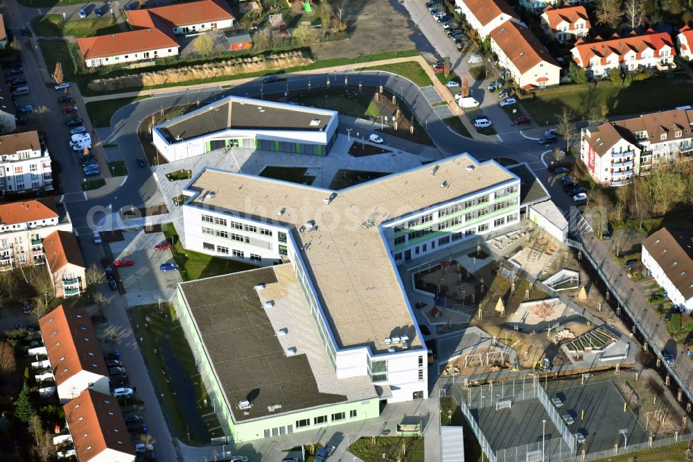 Hönow from the bird's eye view: Construction site for the new building city destrict center between of Schulstrasse and of Marderstrasse in Hoenow in the state Brandenburg, Germany