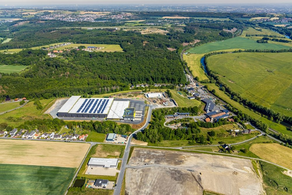 Aerial photograph Arnsberg - New construction of the company administration building and Logistikzentrums of TRIO Leuchten GmbH on Oststrasse in Vosswinkel in the state North Rhine-Westphalia, Germany