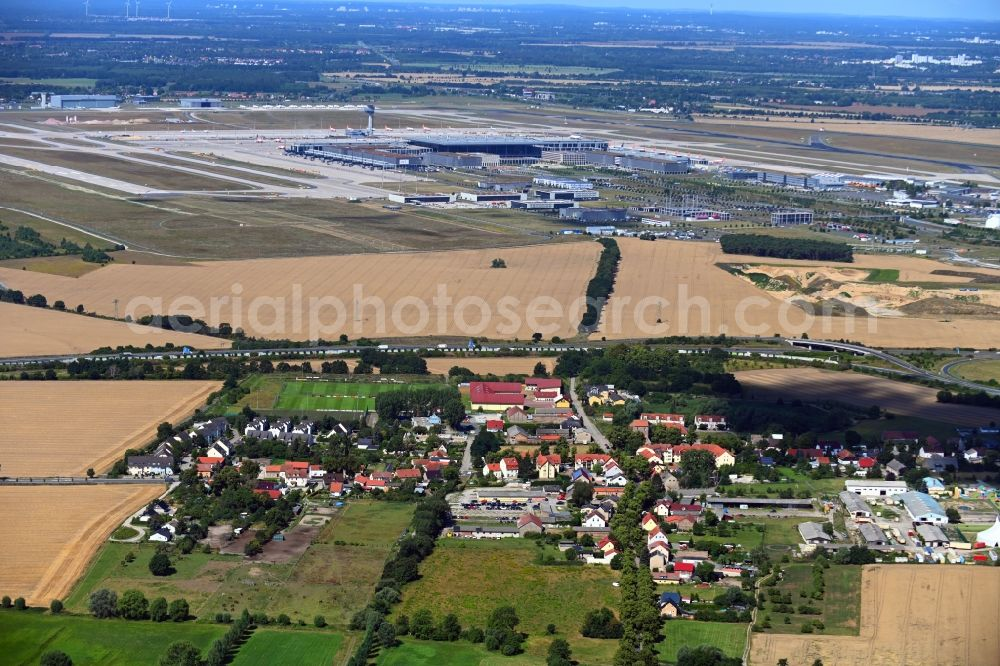 Aerial image Waltersdorf - Village view on the edge of agricultural fields and land in Waltersdorf in the state Brandenburg, Germany