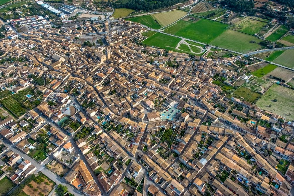 Aerial image Sineu - Town View of the streets and houses of the residential areas in Sineu in Balearische Insel Mallorca, Spain
