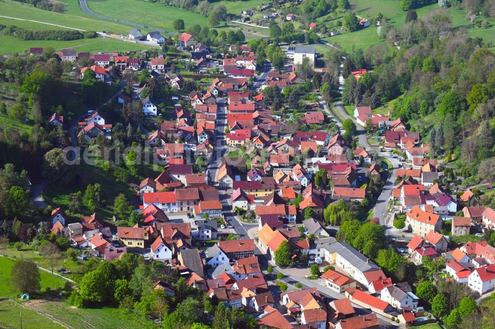 Nazza from the bird's eye view: Location view of the streets and houses of residential areas in the valley landscape surrounded by mountains in Nazza in the state Thuringia, Germany