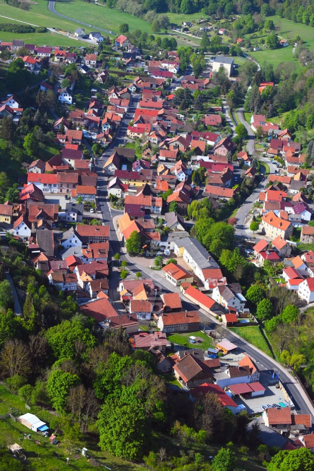 Aerial photograph Nazza - Location view of the streets and houses of residential areas in the valley landscape surrounded by mountains in Nazza in the state Thuringia, Germany