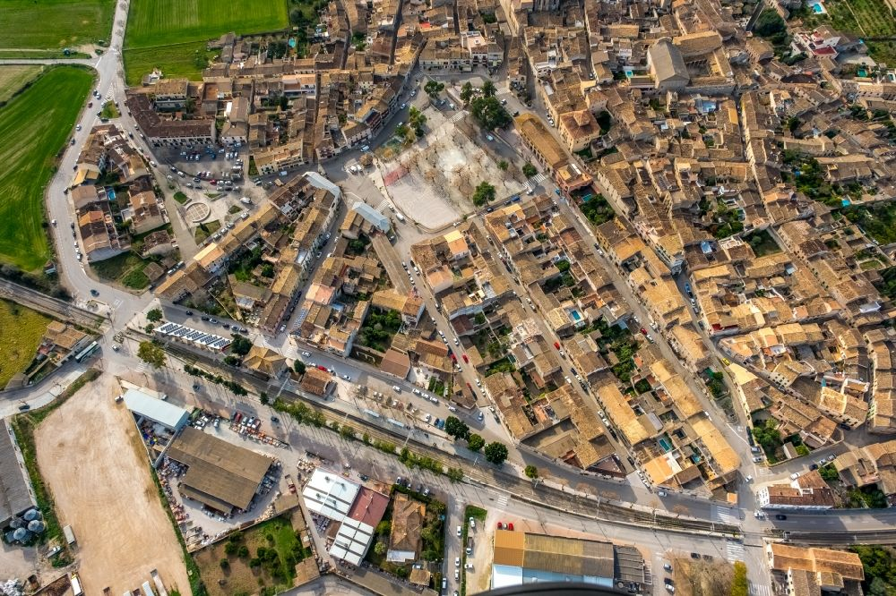 Aerial photograph Sineu - Ensemble space an place Placa es Fossar in the inner city center in Sineu in Balearische Insel Mallorca, Spain