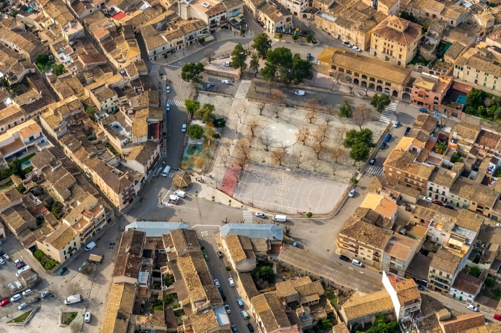 Sineu from the bird's eye view: Ensemble space an place Placa es Fossar in the inner city center in Sineu in Balearische Insel Mallorca, Spain
