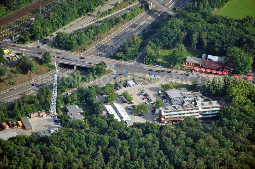 Berlin from the bird's eye view: Motorway service area Grunewald at the highway 115, the Spinner bridge and the motorbike haunt in the district Nikolassee of Berlin-Zehlendorf