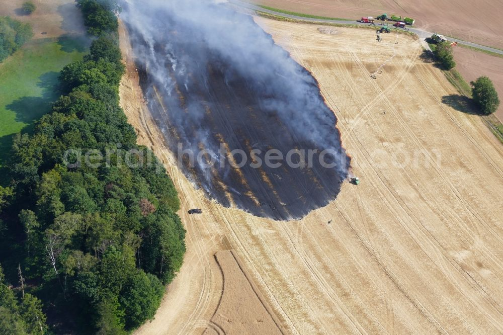Aerial image Dieterode - Smoke clouds of a fire in a cornfield in Dieterode in the state Thuringia, Germany