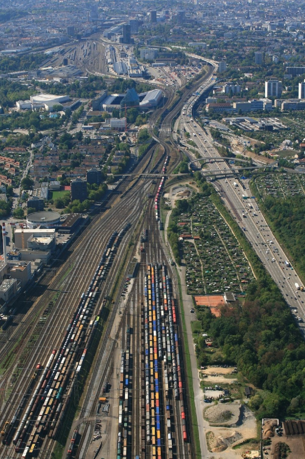 Muttenz from the bird's eye view: Railway tracks and cargo trains in the route network of the Swiss Railway SBB in Muttenz in the canton Basel-Landschaft, Switzerland