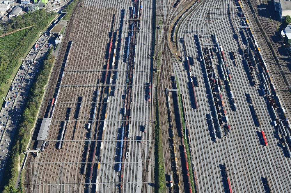 Aerial photograph Muttenz - Railway tracks and cargo trains in the route network of the Swiss Railway SBB in Muttenz in the canton Basel-Landschaft, Switzerland