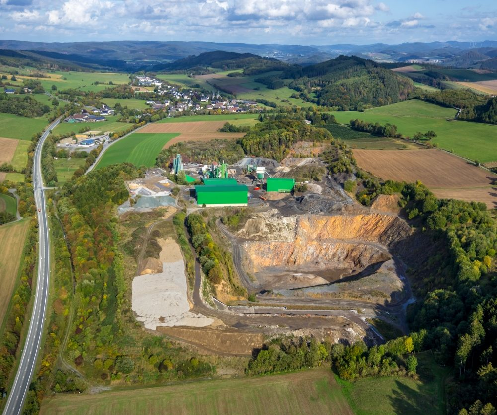 Sundern (Sauerland) from the bird's eye view: Quarry for the mining and handling of limestone in the district Hellefeld in Sundern (Sauerland) in the state North Rhine-Westphalia, Germany. Further information at: Rudolf Hilgenroth GmbH & Co. KG.