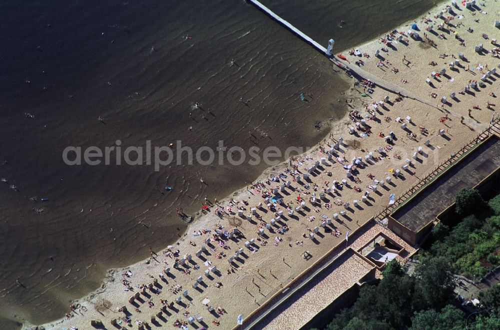 Aerial image Berlin - The bathing beach Wannsee in Berlin-Nikolassee is one of the largest swimming pools on an inland waterway in Europe. Over a century ago, it was opened as a family swimming pool. Up to 12000 bathers here cool off on hot summer days