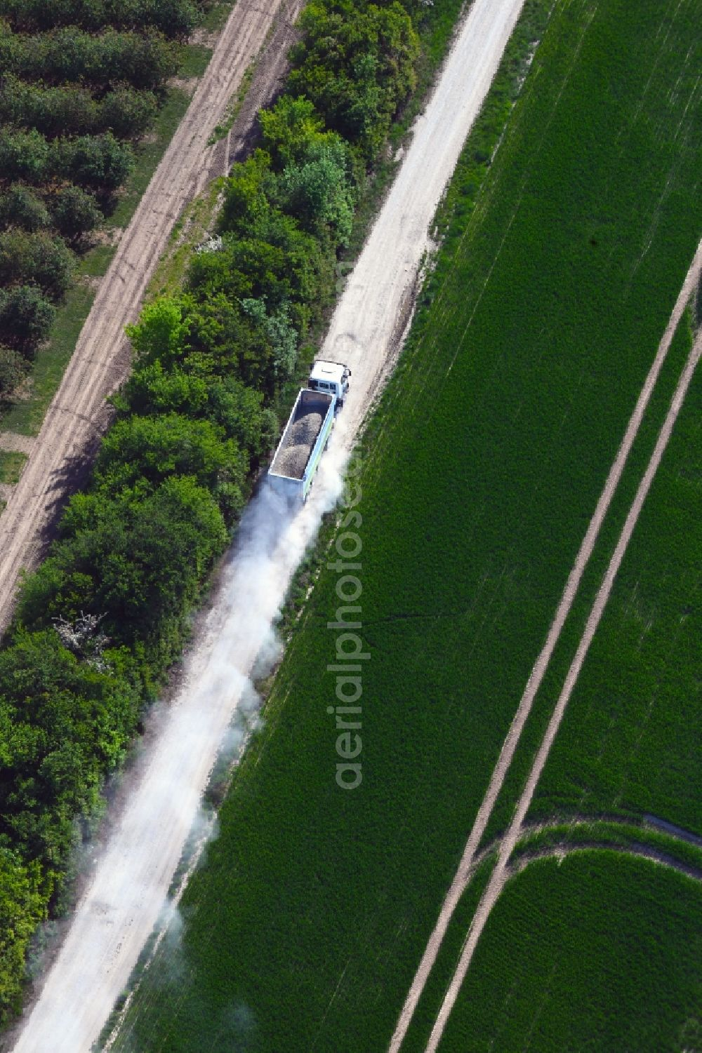 Felchta from above - Transport vehicles in agricultural fields in Felchta in the state Thuringia, Germany