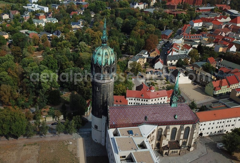 Lutherstadt Wittenberg from the bird's eye view: Castle church of Wittenberg. The castle with high Gothic tower at the west end of the town is a UNESCO World Heritage Site. It gained fame as the Wittenberg Augustinian monk and theology professor Martin Luther spread his disputation
