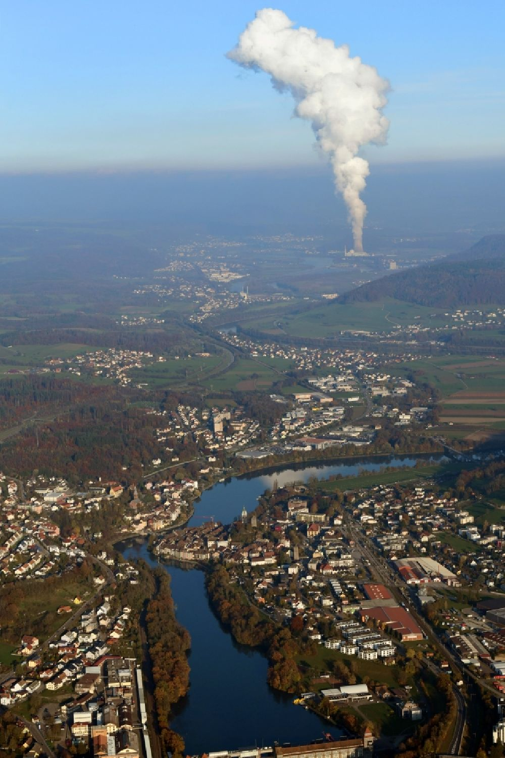 Aerial image Laufenburg - Landscape at the Rhine - river in Laufenburg in the state Baden-Wurttemberg, Germany. Steam column of the NPP nuclear power plant KKL Leibstadt in Switzerland.