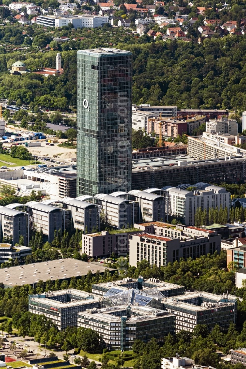 Aerial photograph München - The headquarters Uptown of Telefonica Germany and Astellas Pharma on Georg Brauchle Ring in Munich in the state of Bavaria. The telecommunication company is seated in the glas tower with the 02 logo. The pharmaceutical company is in the complex with glas arches