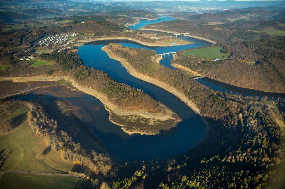 Aerial photograph Olpe - Low water level and lack of water caused the shoreline areas to be exposed of Biggesee in Olpe in the state North Rhine-Westphalia, Germany