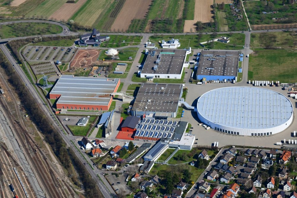 Aerial image Weil am Rhein - Building and production halls on the premises of the furniture manufacturer Vitra in Weil am Rhein in the state of Baden- Wuerttemberg form a unique ensemble of contemporary architecture. The buildings of many renowned architects lure design and architecture lovers and students in the city on the border triangle near Basel