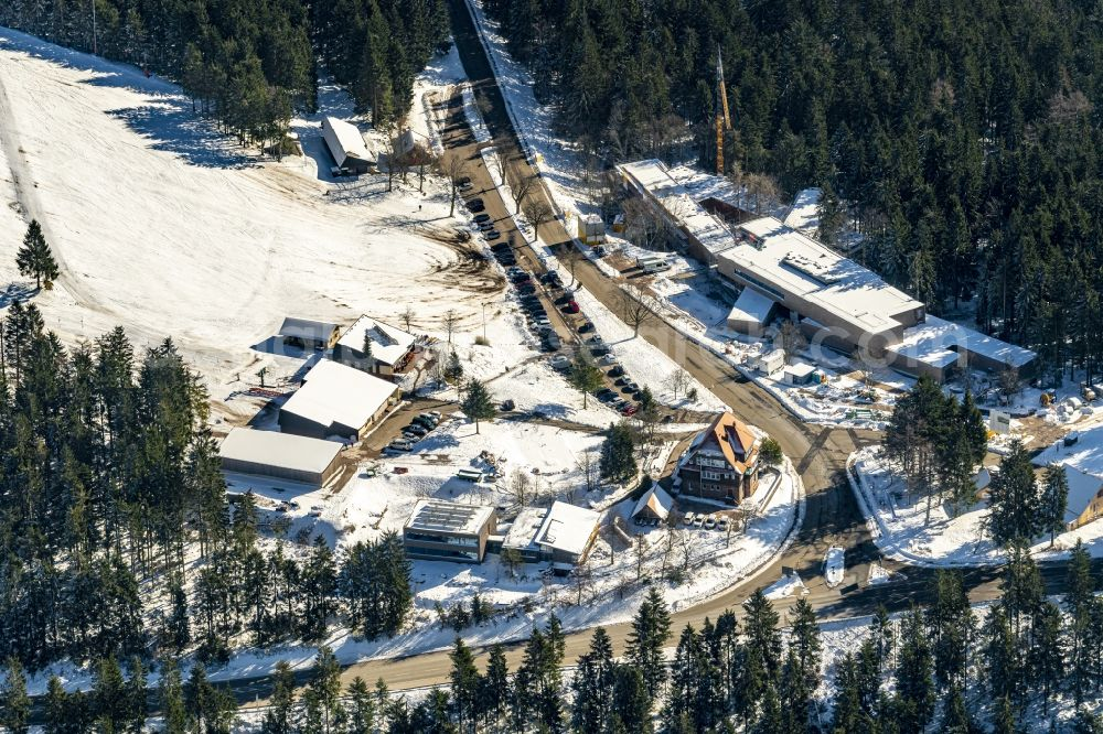 Baiersbronn from above - Wintry snowy construction site for the new building Naturschutzzentrum Ruhestein in Baiersbronn in the state Baden-Wurttemberg, Germany