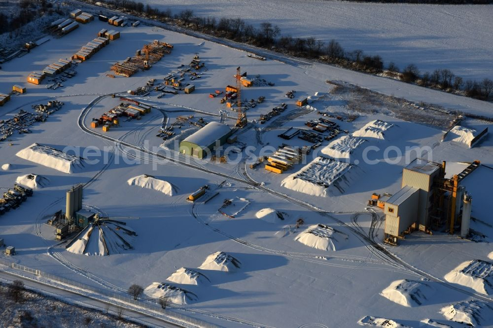 Werneuchen from above - Wintry snowy mixed concrete and building materials factory of Berger Bau GmbH on Alte Hirschfelder Strasse in Werneuchen in the state Brandenburg