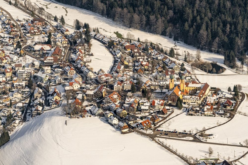 Aerial image Sankt Märgen - Wintry snowy complex of buildings of the monastery in Sankt Maergen in the state Baden-Wurttemberg, Germany