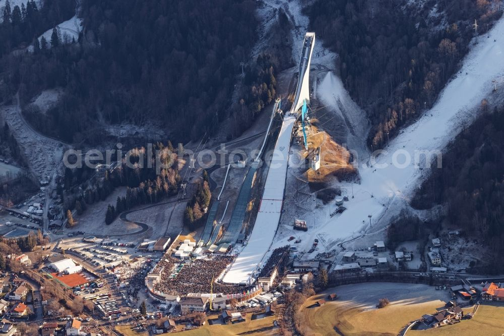 Aerial photograph Garmisch-Partenkirchen - Wintry snowy training and competitive sports center of the ski jump Grossen Olympiaschanze on Karl-und Martin-Neuner-Platz in Garmisch-Partenkirchen in the state Bavaria, Germany