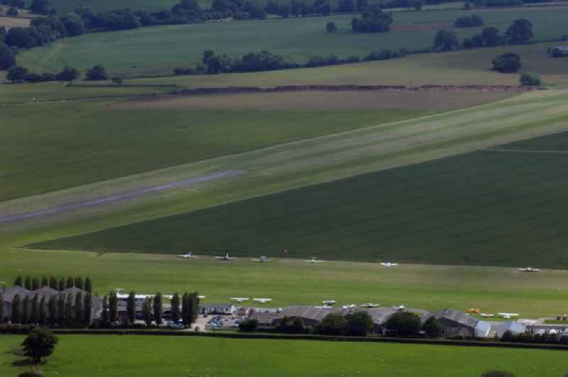 View at the  airstrip and several small planes parked on the Stapleford Airfield in Abridge in Essex in the UK. The airfield is located inthe vicinity of London