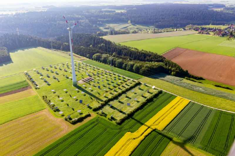 Wind turbine windmills on a solar panel field in Alpirsbach in the state Baden-Wurttemberg, Germany