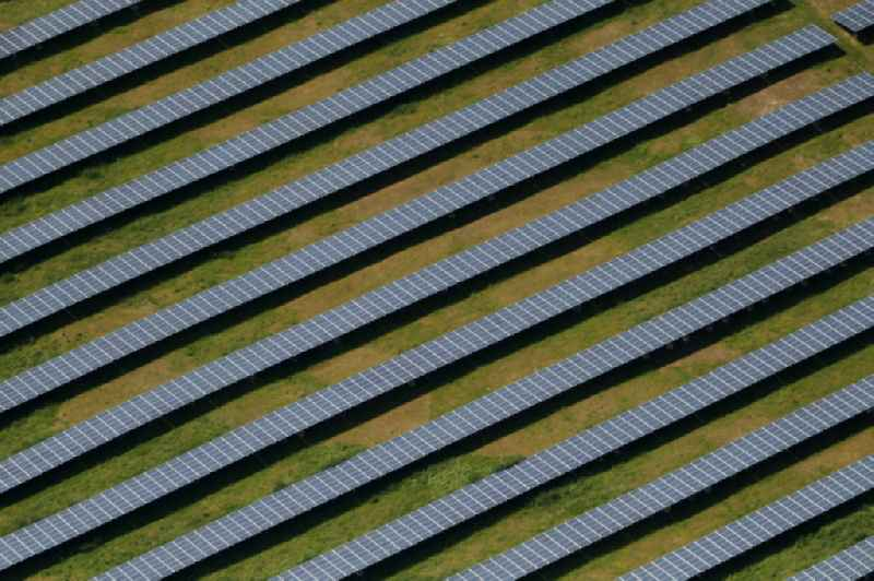Panel rows of photovoltaic and solar farm or solar power plant in Artern/Unstrut in the state Thuringia, Germany