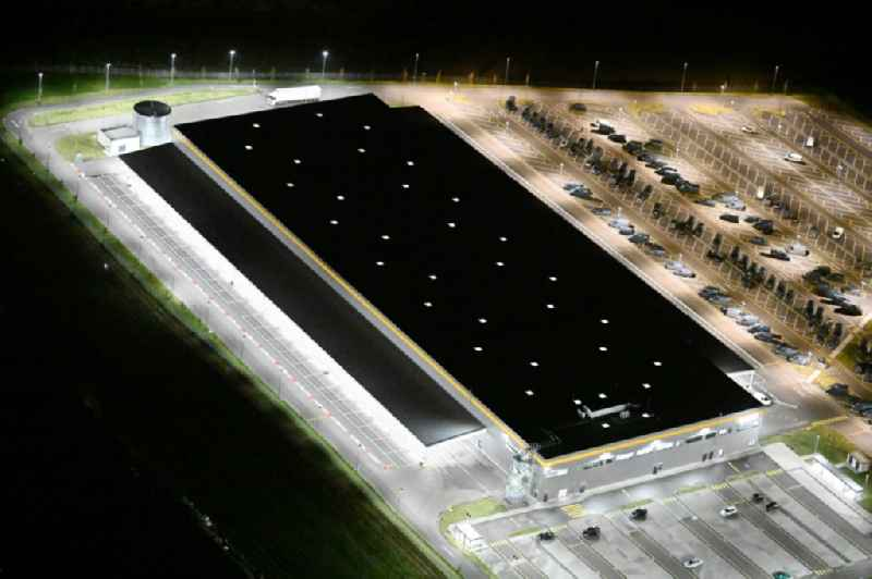 Night lighting building complex and distribution center on the site of an 'Amazon' logistics center in Gewerbegebiet Teichkoppel in Bad Oldesloe in the state Schleswig-Holstein, Germany
