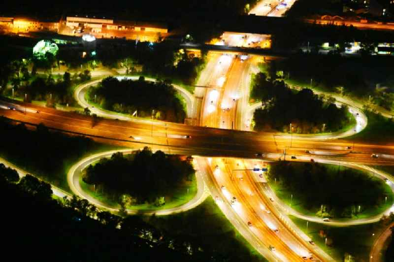 Night lighting traffic flow at the intersection- motorway A 100 to the A103 in the district Tempelhof-Schoeneberg in Berlin, Germany
