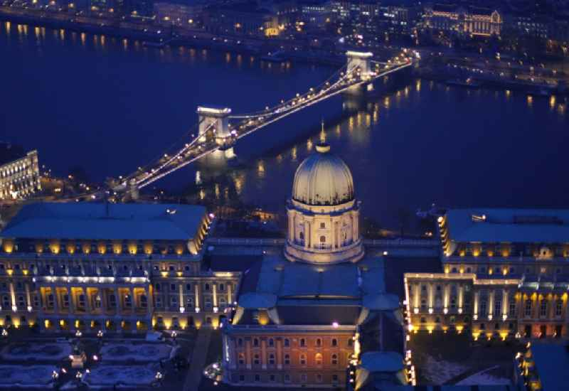 Night lights and lighting Palace of the 'Royal Palace' with the chain bridge over the Danube in Budapest in Hungary