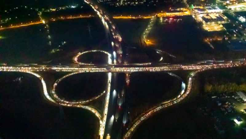 Night lighting traffic flow at the intersection- motorway A40 - 45 'Kreuz Dortmund-West' in form of cloverleaf in the district Oespel in Dortmund in the state North Rhine-Westphalia, Germany. Further information at: Landesbetrieb Strassenbau Nordrhein-Westfalen.